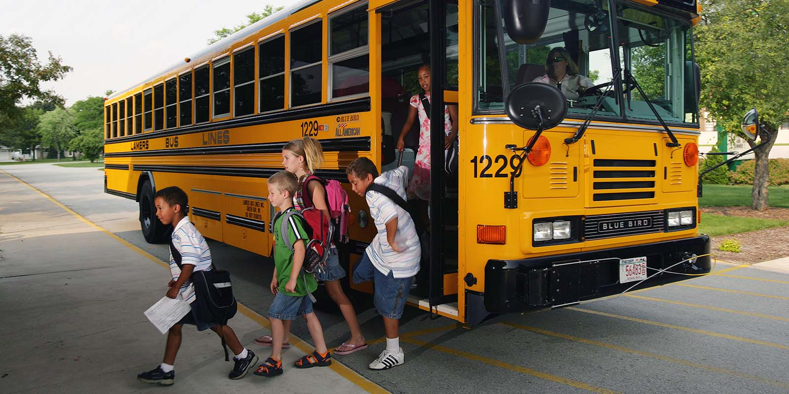 Lamers Bus Lines, Inc. school bus dropping off children