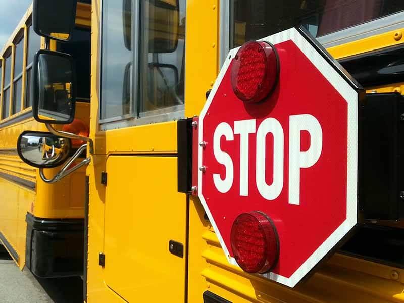 Lamers Bus Lines, Inc. school bus stop sign arm