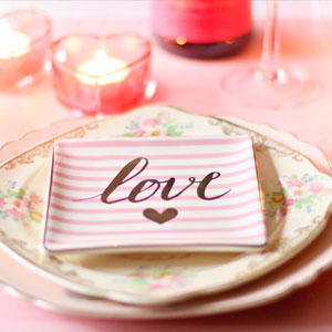 plate setting with the word love on it
