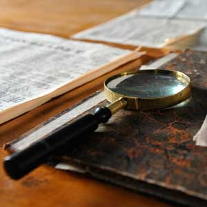 magnifying glass and papers