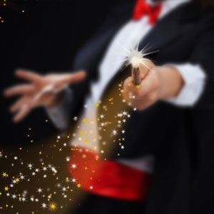 Magician hands with sparkling stars